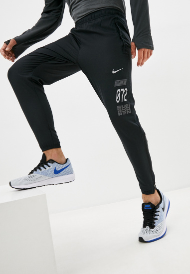 Спортивні штани NIKE ESSN - фото